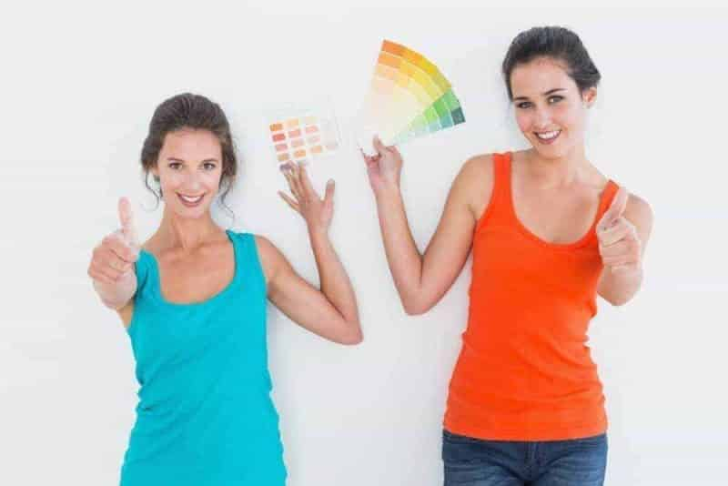 Two girls showing rainbow colours